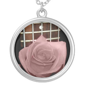 Muted dark pink rose with five string bass fboard round pendant necklace