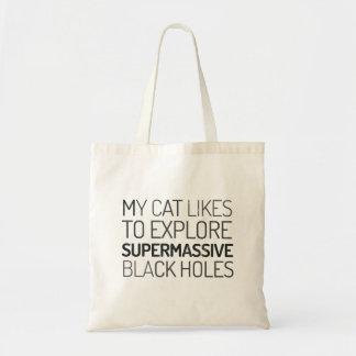 My cat likes to explore supermassive black holes tote bag
