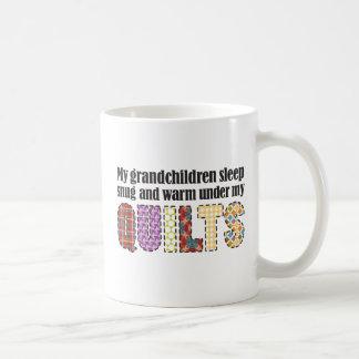 My grandchildren sleep snug under my quilts coffee mug