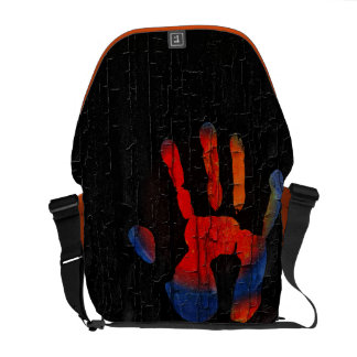My hand with fire on wood messenger bag