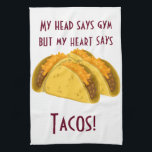"My head says gym but my heart says tacos kitchen towel<br><div class=""desc"">This is so funny. How many of us know this feeling so well. The ultimate for those suffering from a love of tacos. The text can be altered so change it if you wish. Maybe add a name. There is no additional charge to do this. Great for people who love...</div>"