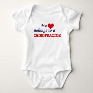 My heart belongs to a Chiropractor Baby Bodysuit