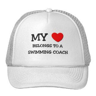 My Heart Belongs To A SWIMMING COACH Trucker Hats