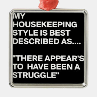 MY-HOUSEKEEPING-STYLE-IS-BEST-DESCRIBED-AS-THERE-A METAL ORNAMENT