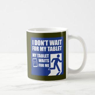 My tablet waits for me coffee mug