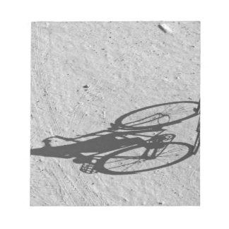 Myamar, Bagan, Young boy riding a huge bike and Notepad
