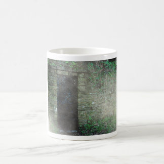Mysterious doorway in a stone wall coffee mugs