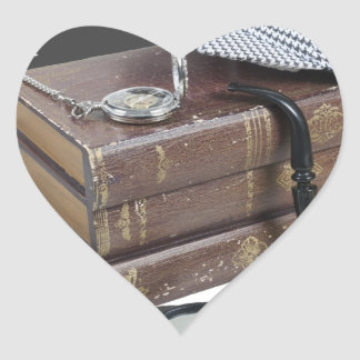 MysteryBooksHatPipeMagnifier042113.png Heart Sticker
