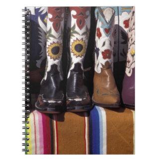 NA, USA, New Mexico, Santa Fe. Cowboy boots Spiral Notebook