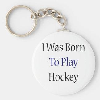 Nací jugar a hockey llavero redondo tipo pin