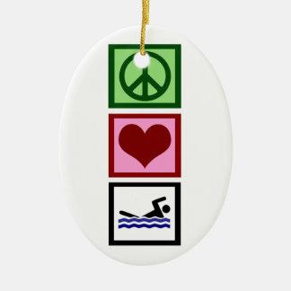 Nadada del amor de la paz adorno ovalado de cerámica