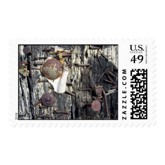 nails in a telephone pole postage stamps