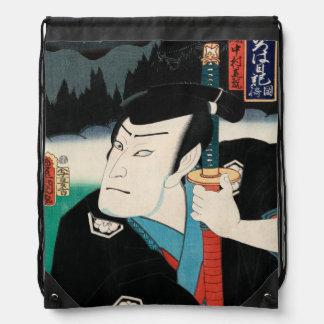 Nakamura Shikan IV en el papel de Fuwa Kazuemon Mochila