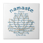 """Namaste Lotus Tile<br><div class=""""desc"""">Lovely text based design featuring a quote about the meaning of the word Namaste superimposed on a simple lotus flower.</div>"""
