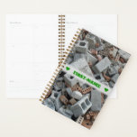 "Name   Bricks &amp; Blocks Demolition Rubble Debris Planner<br><div class=""desc"">This planner design features a photo of demolition rubble that contains bricks, concrete blocks, and other building wreckage debris. The front also features a customizable name between two heart shapes in green-colored text, within a hazy light gray colored area. A planner like this might make a great personalized gift for...</div>"