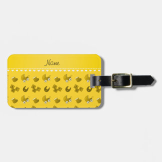 Name yellow baby bib blocks carriage booties bag tag