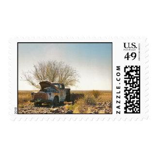 Namibian truck wreck under tree in desert postage
