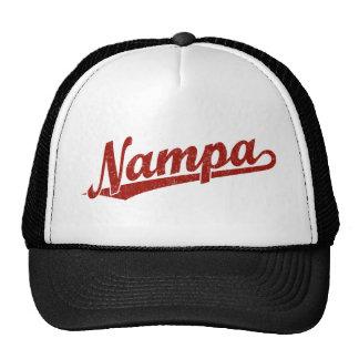 Nampa script logo in red distressed trucker hats