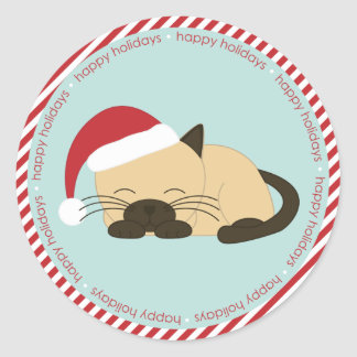 Napping Cat Wearing a Santa Hat Classic Round Sticker
