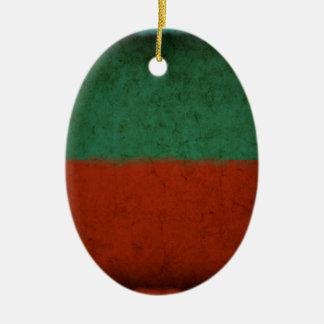 Naranja azulverde rojo de los campos de color del adorno navideño ovalado de cerámica