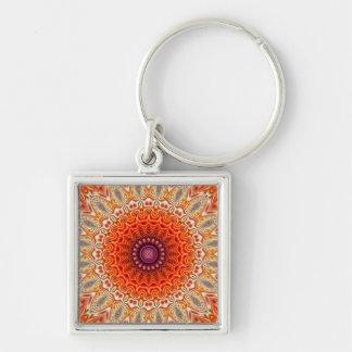 Naranja caleidoscópico de la flor y diseño del bla llavero