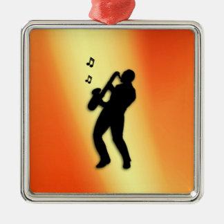 Naranja del jugador de saxofón adorno navideño cuadrado de metal