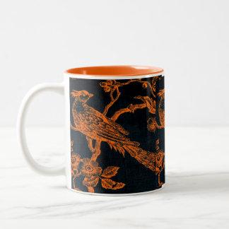 Naranja en taza bosquejada negra del modelo del