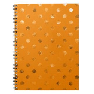 Naranja metálico del lunar de la hoja del oro de libros de apuntes