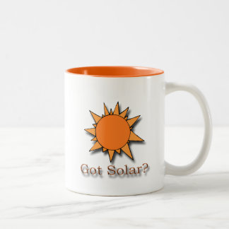 Naranja solar conseguido taza de café de dos colores