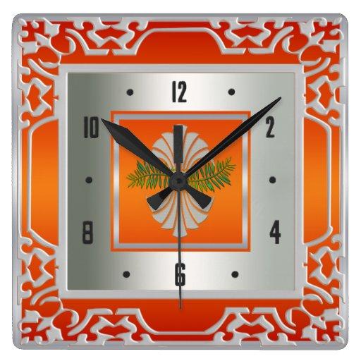 Naranja y reloj de pared alineado plata de los