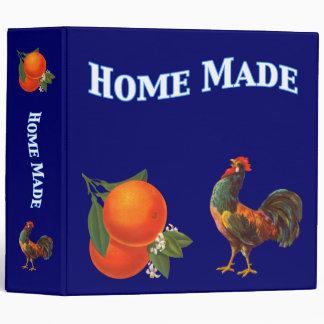 Naranjas y carpeta de la receta del arte del vinta