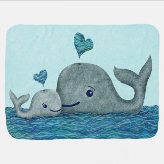 Natación de la mamá y del bebé de la ballena en el mantita para bebé