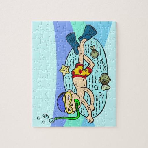 Natación del muchacho con los pescados puzzle