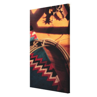 Native American blanket , lasso , and spurs Canvas Print