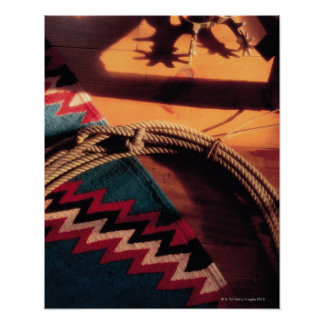 Native American blanket , lasso , and spurs Poster