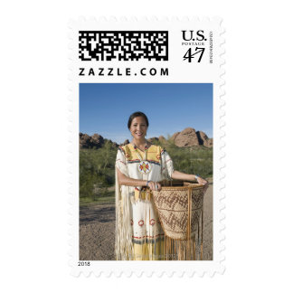 Native American woman in traditional clothing Stamp