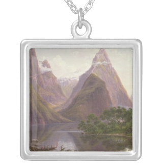 Native figures in a canoe at Milford Sound Silver Plated Necklace