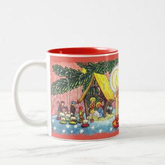 Natividad debajo de la taza del árbol de navidad