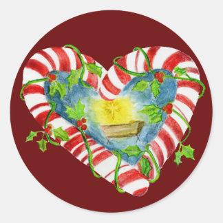 Natividad en corazón del bastón de caramelo pegatina redonda