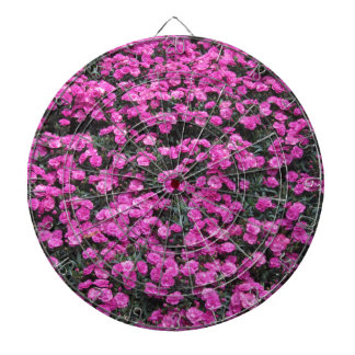 Natural background of purple carnation flowers dart board