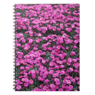 Natural background of purple carnation flowers spiral notebook
