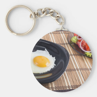 Natural homemade breakfast of fried egg and salad keychain