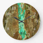 Natural turquoise vein in rough brown stone wall clocks