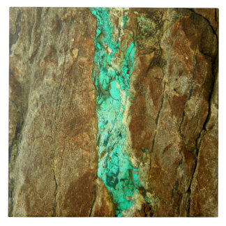 Natural turquoise vein in rough brown stone tile