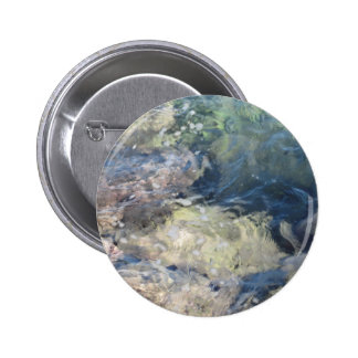 Nature background of transparent sea water flowing button