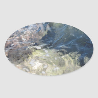 Nature background of transparent sea water flowing oval sticker
