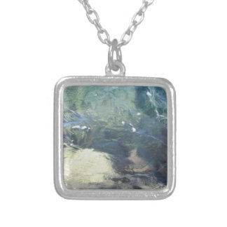 Nature background of transparent sea water flowing silver plated necklace