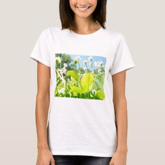 Nature beautiful sunlit clover field. T-Shirt
