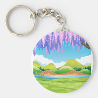Nature scene with green field and willow tree basic round button keychain
