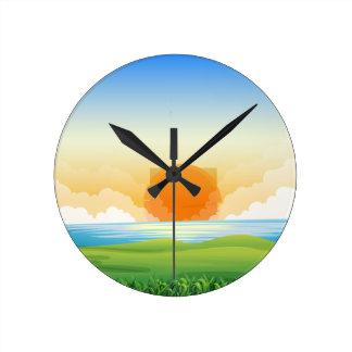 Nature scene with sunset round clock